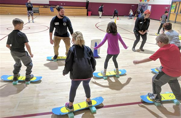 Students their first lesson in standing on a snowboard from Thalia Villarosa of Beech Mountain.