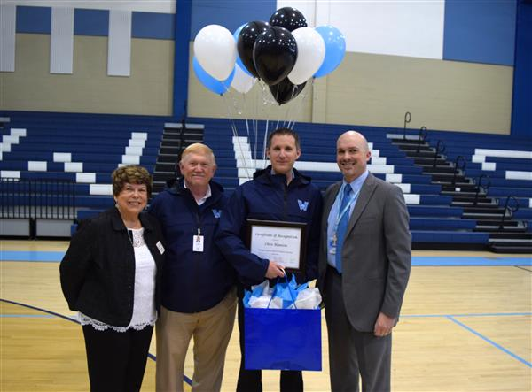 Blanton is joined by school board chairman Ron Henries, Vice Chair Brenda Reese and Dr. Scott Elliott.