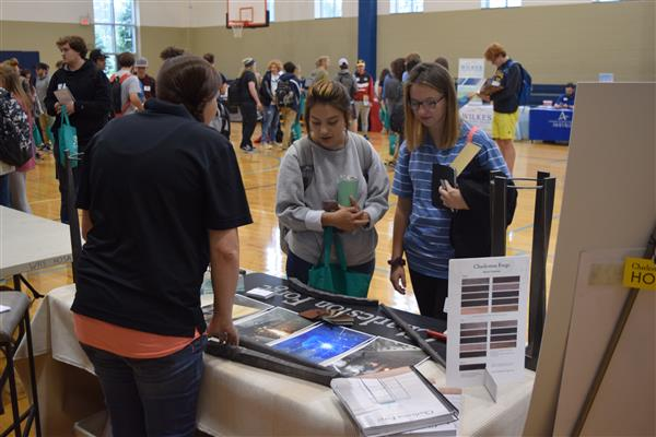 WHS Seniors Laura Tellez-Elias and Alivya Stamey visit Charleston Forge's booth at the college and