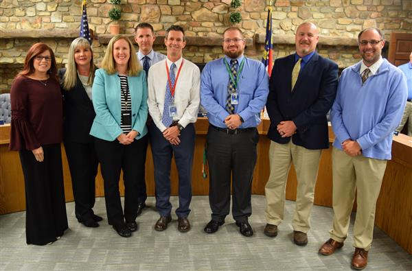 Spelling bee winner Sam Nystrom with parents and school staff.
