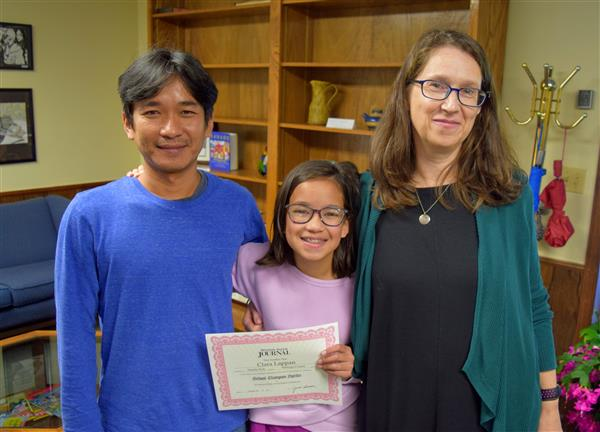 Watauga County Schools district spelling bee winner Clara Lappan with parents Susan Lappan and Teguh Priyanto.
