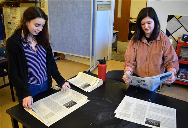 WHS Students fold an edition of the Powder Horn newspaper.