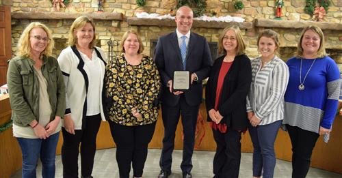 National Board Certified teachers were recognized at the December Board of Education meeting.