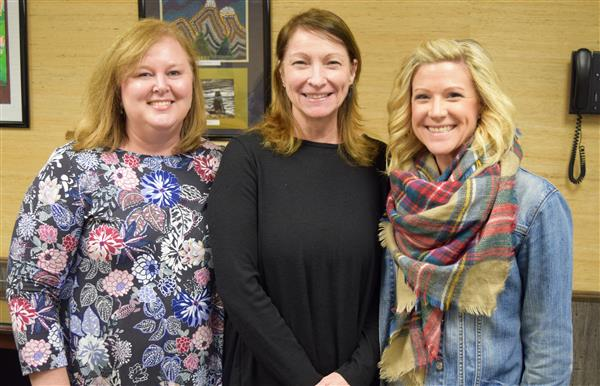 Three WCS counselors were pose for a photo at the WCS central office after being recognized.