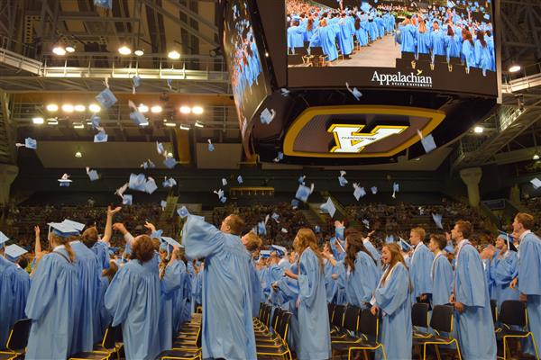 Watauga High School students toss caps in celebration of graduation last year.