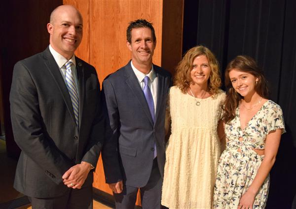 Norman pictured with his wife Candace; daughter Carolina, and WCS Superintendent Dr. Scott Elliott.