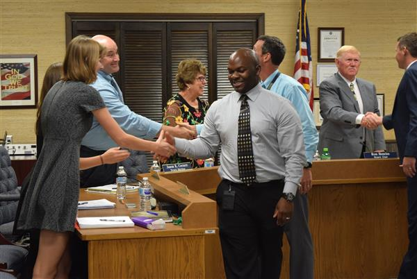 Watauga County Schools principals shake hands with school board members