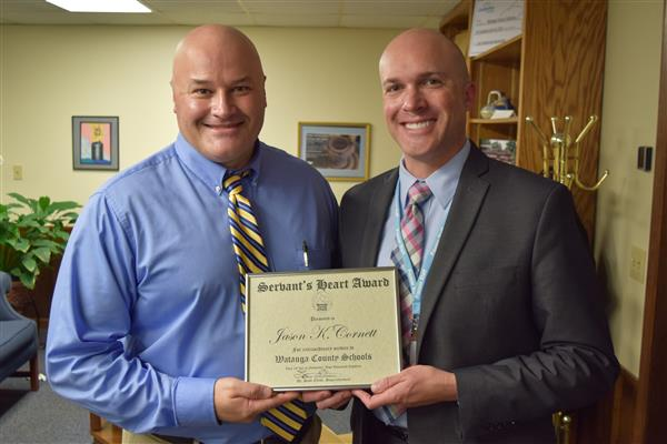 Cornett and Elliott pose with the Servant's Heard Award at the WCS Central Office.
