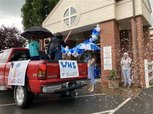 A truck pulls through Parkway School's promotion ceremony in a shower of confetti.