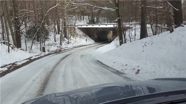 Elliott stops to take a photo of snowy road during a road check last winter